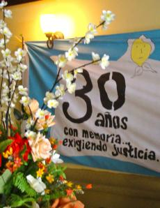 "Banner at COFADEH's 30th anniversary celebration: ""30 years of memory demanding justice"""