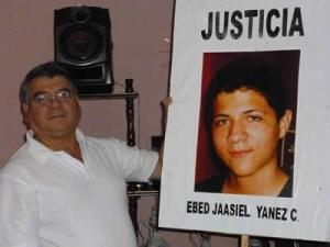 Ebed Yanes's father (link in Spanish). The 15-year-old was killed by the Honduran military. The case is one of 4 to be presented to the ICC.